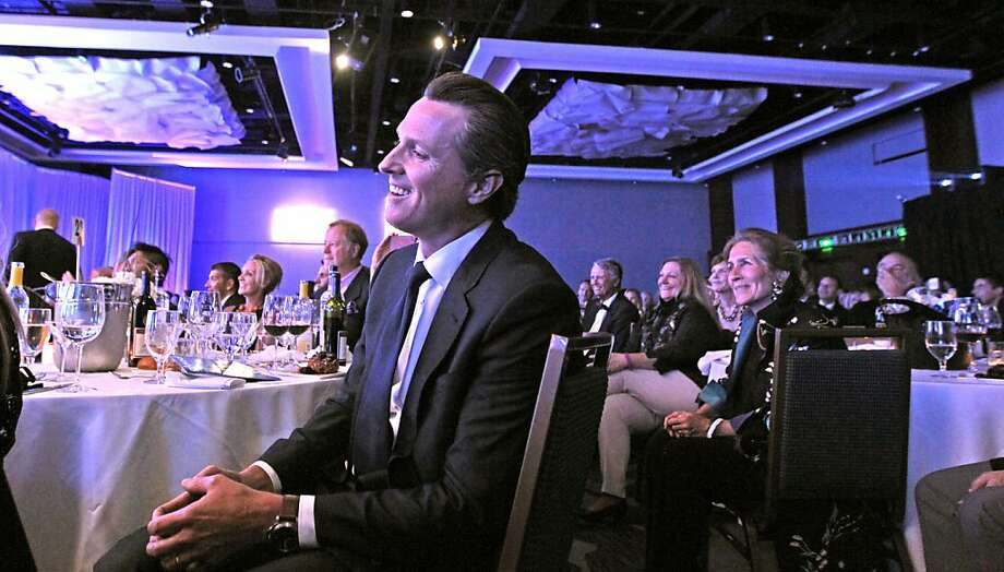 Lieutenant Governor Gavin Newsom, listens to his introduction by his wife Jennifer Siebel Newsom, at the GLAAD media awards Saturday, May 11, 2013 in San Francisco, Calif. Photo: Lance Iversen, The Chronicle