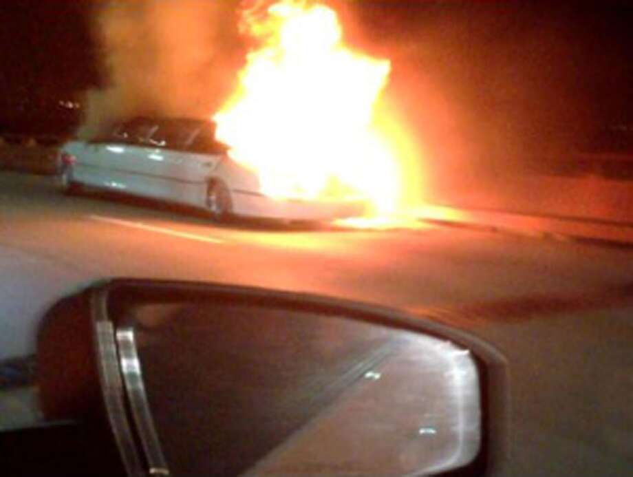 This frame grab taken from video provided by Roxana and Carlos Guzman shows a Limo on fire Saturday, May 4, 2013, on the San Mateo-Hayward Bridge in San Francisco. Five dead female bodies were found pressed up against the partition behind the driver, where they apparently tried to escape the smoke and fire that kept them from the rear exits of the extended passenger compartment. Photo: AP