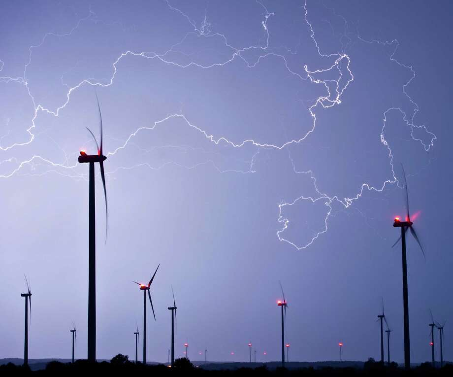 In this picture made available Friday, May 10, 2013, flashlights light the sky over a wind energy park during a thunderstorm near Jacobsdorf, eastern Germany, Thursday, May 9, 2013. Photo: AP