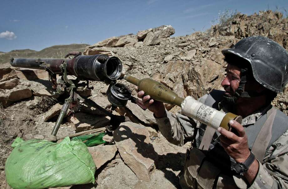 An Afghan border policeman arms a rocket launcher on his position at the border between Afghanistan and Pakistan in Goshta district of Jalalabad province east of Kabul, Afghanistan, Thursday, May 9, 2013. Afghan President Hamid Karzai on Thursday warned Pakistan against trying to force Afghanistan to accept as an international border the Durand line which separates the two countries. Border tensions between the two countries have escalated dramatically in the last two weeks with both sides accusing the other of unprovoked attacks. Photo: AP
