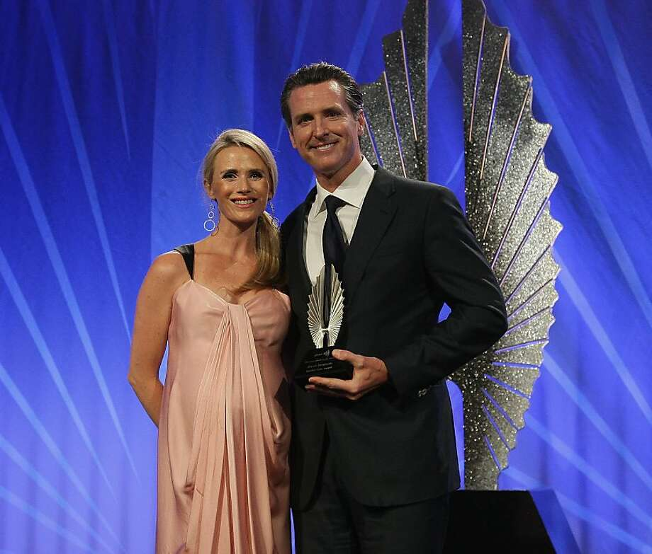 Lieutenant Governor of California Gavin Newsom (right), poses a for a photoo with his wife Jennifer Siebel Newsom after being awarded the Golden Gate Award during the 24th Annual GLAAD Media Awards at the Hilton San Francisco - Union Square on May 11, 2013 in San Francisco, California.  (Photo by John Medina/WireImage) Photo: John Medina, WireImage
