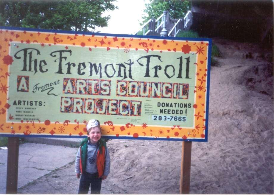 Nick, son of project coordinator Barb Luecke, at Troll volunteer sign.  (Photo courtesy of Michael Falcone and 'The Hall of Giants')