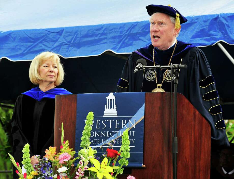 Former Newtown Superintendent of Schools, Janet Robinson is honored by WCSU President James Schmotter as the class of 2013 graduates during Western Connecticut State University's 115th Commencement Exercises in Danbury, Conn. Sunday, May 12, 2013. Photo: Michael Duffy / The News-Times