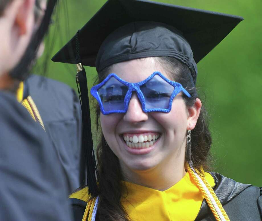 Patricia Campos, of Danbury, smiles as the class of 2013 graduates during Western Connecticut State University's 115th Commencement Exercises in Danbury, Conn. Sunday, May 12, 2013. Photo: Michael Duffy / The News-Times