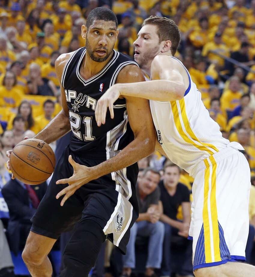 The Spurs' Tim Duncan looks for room around the Warriors' David Lee during first half action in Game 4 of the Western Conference semifinals Sunday, May 12, 2013 at Oracle Arena in Oakland.