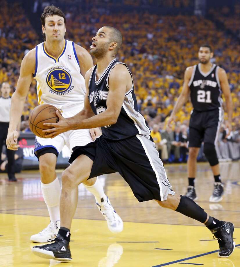 The Spurs' Tony Parker drives around the Warriors' Andrew Bogut during first half action in Game 4 of the Western Conference semifinals Sunday, May 12, 2013 at Oracle Arena in Oakland.