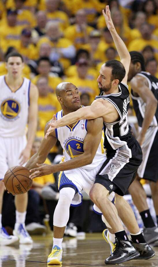 The Spurs' Manu Ginobili defends the Warriors' Jarrett Jack during first half action in Game 4 of the Western Conference semifinals Sunday, May 12, 2013 at Oracle Arena in Oakland.