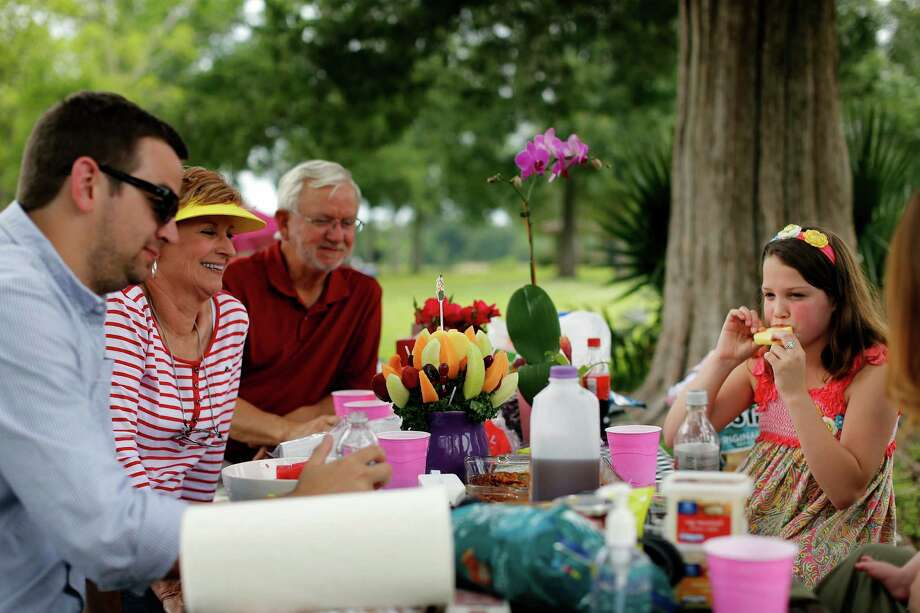 Harrison Fama, left, celebrates Mother's Day with his mother, Kaye, and father, Tony, along with 10-year-old Alexa Jackson, right, Sunday, May 12, 2013 at Bay Area Park in Houston. Photo: © TODD SPOTH, 2013 / © TODD SPOTH, 2013