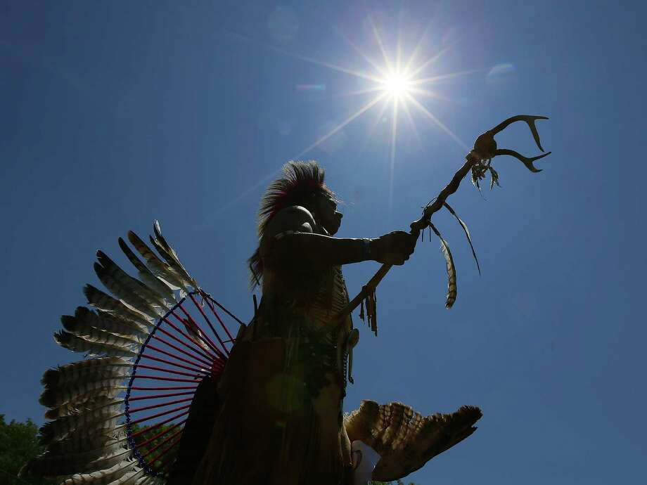 Cherokee Indian Tommy Martinez, of Jackson, Ga., takes part in the 24th Annual Cherokee County Indian Festival & Mother's Day Powwow at Boling Park on Sunday, May 12, 2013, in Canton, Ga. Martinez performed several native dances while taking part in inter-tribal competition Photo: Curtis Compton, Associated Press / Atlanta Journal-Constitution