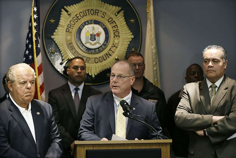 Mercer County Prosecutor Joseph Bocchini Jr. (left), New Jersey State Police Superintendent Col. Rick Fuentes and Trenton Police Director Ralph Rivera Jr. discuss the long ordeal. Photo: Mel Evans, Associated Press