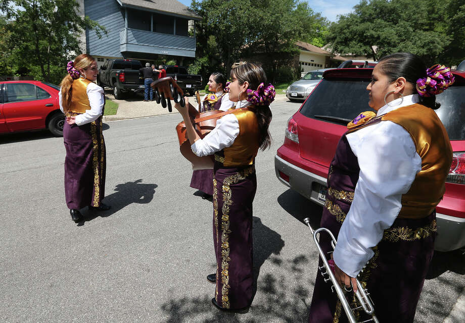 "Mariachi Flor de Jalisco arrives for a Mother's Day serenade at the Martinez residence in north central San Antonio, Sunday, May 12, 2013. Tradicional mariachi songs, such as ""Las Mananitas"" are part of the repertoire. Part of the group are from left, Debra Torres, Rebecca Martinez, Amanda Lozano and Cecilia Ortiz. Photo: JERRY LARA, San Antonio Express-News / © 2013 San Antonio Express-News"