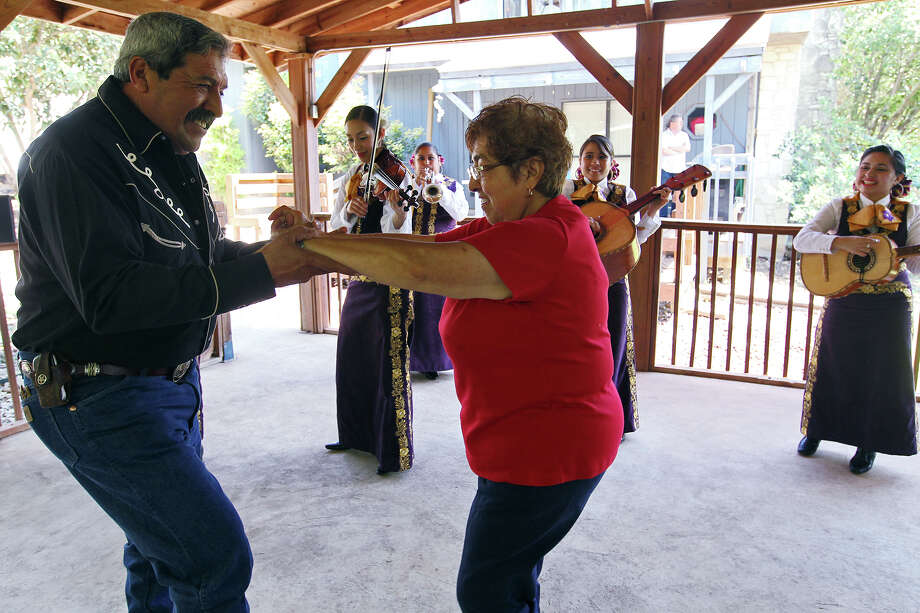 Juan Martinez, 59, dances with his mother, Dora Martinez, 74, as Mariachi Flor de Jalisco serenades her for Mother's Day, Sunday, May 12, 2013 in San Antonio. Photo: JERRY LARA, San Antonio Express-News / © 2013 San Antonio Express-News