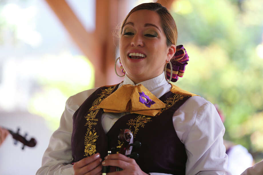 Debra Torres, of Mariachi Flor de Jalisco, sings while performing Mother's Day serenatas at the Martinez residence in north central San Antonio, Sunday, May 12, 2013. Photo: JERRY LARA, San Antonio Express-News / © 2013 San Antonio Express-News