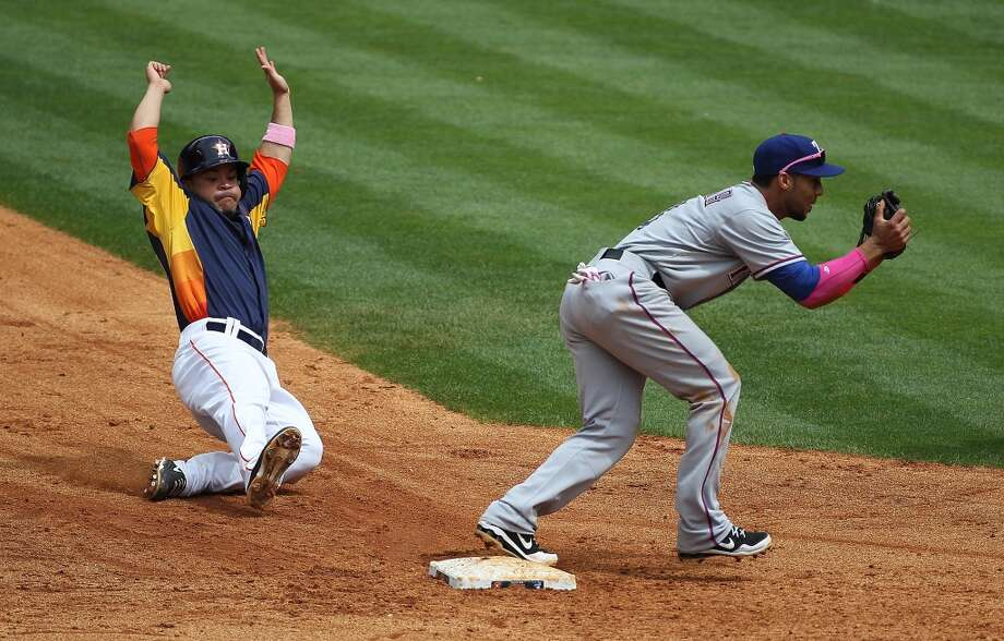 May 12: Rangers 12, Astros 7 Astros second baseman Jose Altuve tries to slide into second base before the ball makes it.
