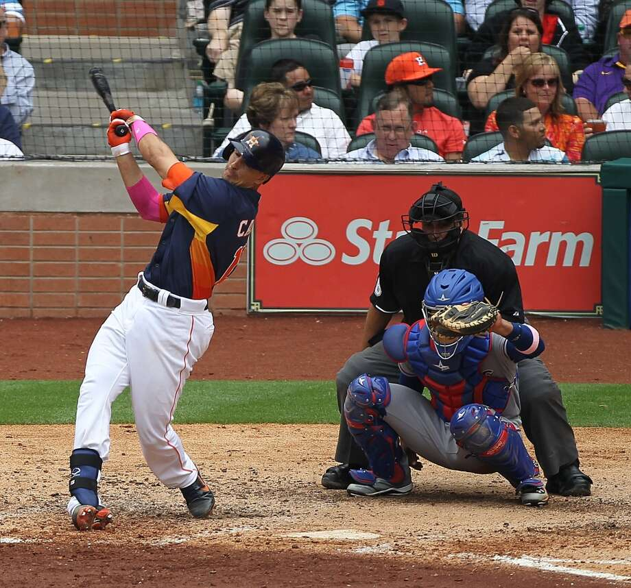 Jason Castro of the Astros hits a home run during the fifth inning. Photo: Nick De La Torre, Houston Chronicle