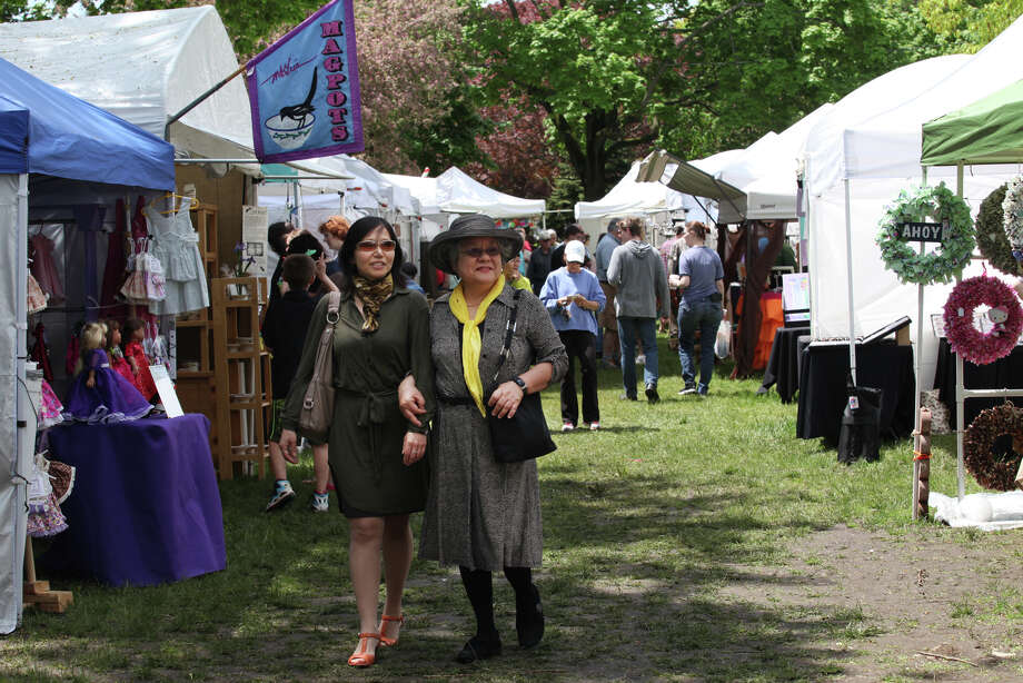 Kiko Nishimura, left and her mother, Kiyo, both of Fort Lee, NJ, stroll through the Mothers Day Arts & Crafts show on the Milford  green on Sunday, May 12. 2013. Photo: BK Angeletti, B.K. Angeletti / Connecticut Post freelance B.K. Angeletti