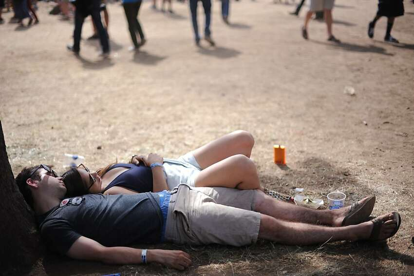 Garett Melin of Temecula, California and Kristyn Carter of Antioch, California taking a break from the heat during the Bottle Rock Napa Valley festival Saturday. May 11, 2013.