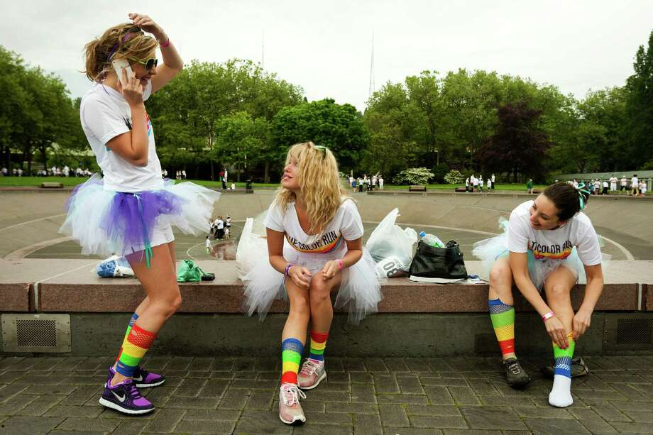 Runners perfect their tutus and rainbow socks before the Color Run 5k Sunday, May 12, 2013, in Seattle. The sold out event - also known as the Happiest 5k on the Planet - is a unique paint race celebrating healthiness, happiness and individuality. Photo: JORDAN STEAD, SEATTLEPI.COM / SEATTLEPI.COM