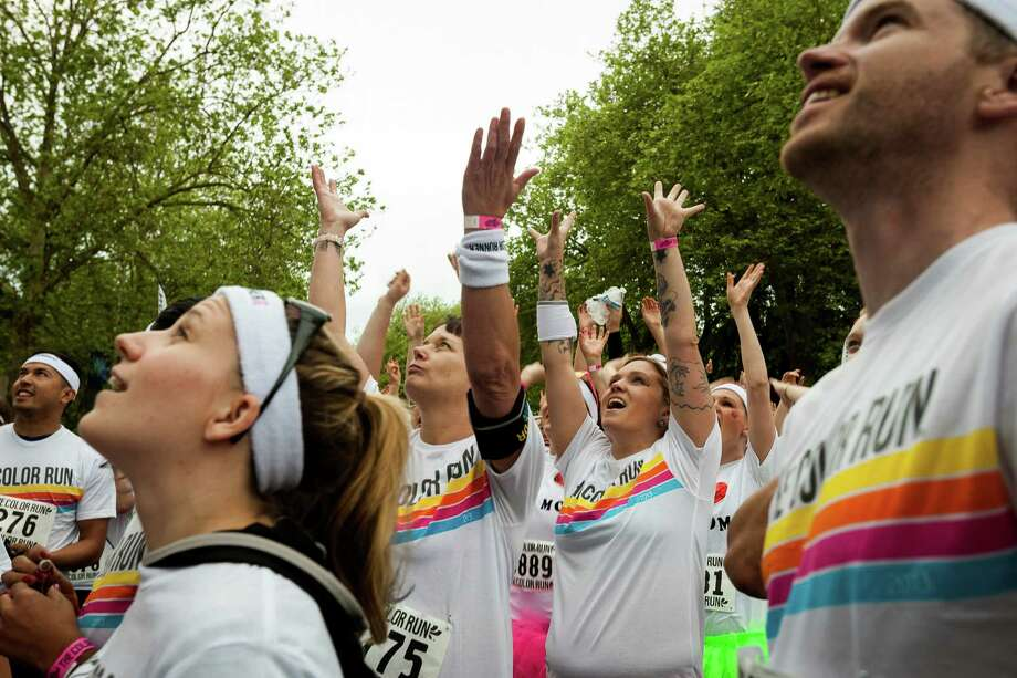 Participants get psyched at the starting line of the Color Run 5k Sunday, May 12, 2013, in Seattle. The sold out event - also known as the Happiest 5k on the Planet - is a unique paint race celebrating healthiness, happiness and individuality. Photo: JORDAN STEAD, SEATTLEPI.COM / SEATTLEPI.COM