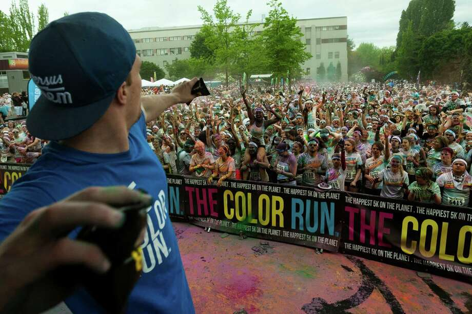 Following the completion of the running segment, thousands of eager participants took to the grounds outside of the Experience Music Project to dance, throw powder and take pictures at the Color Run 5k Sunday, May 12, 2013, in Seattle. The sold out event - also known as the Happiest 5k on the Planet - is a unique paint race celebrating healthiness, happiness and individuality. Photo: JORDAN STEAD, SEATTLEPI.COM / SEATTLEPI.COM