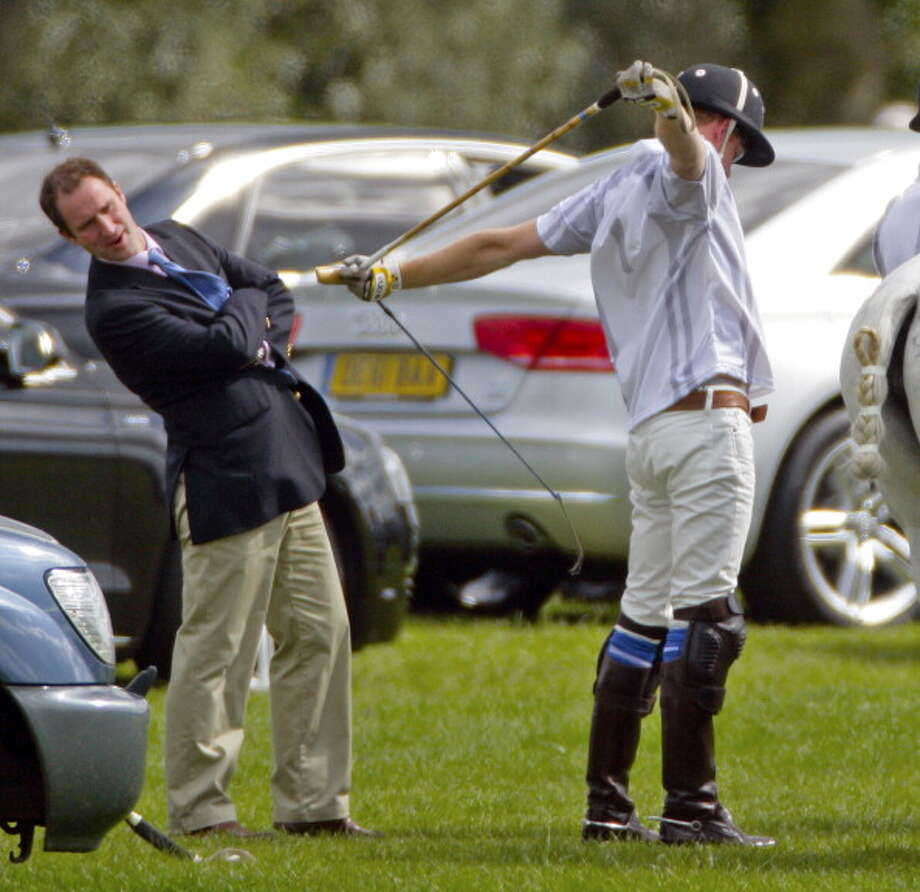ASCOT, UNITED KINGDOM - MAY 12: (EMBARGOED FOR PUBLICATION IN UK NEWSPAPERS UNTIL 48 HOURS AFTER CREATE DATE AND TIME) Prince Harry stretches prior to playing in the Audi Polo Challenge charity polo match at Coworth Park Polo Club on May 12, 2012 in Ascot, England. (Photo by Indigo/Getty Images) Photo: Max Mumby/Indigo, Getty Images / Getty Images