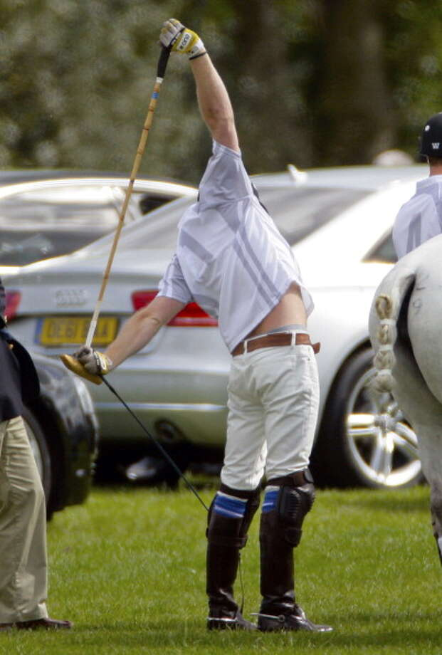 ASCOT, UNITED KINGDOM - MAY 12: (EMBARGOED FOR PUBLICATION IN UK NEWSPAPERS UNTIL 48 HOURS AFTER CREATE DATE AND TIME) Prince Harry stretches prior to playing in the Audi Polo Challenge charity polo match at Coworth Park Polo Club on May 12, 2012 in Ascot, England. (Photo by Indigo/Getty Images) Photo: Indigo, Getty Images / Getty Images