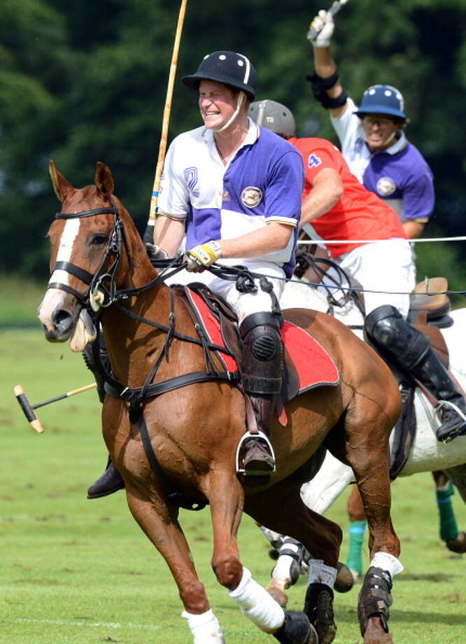CIRENCESTER - AUGUST 05:  Prince Harry plays in the Jerudong Trophy at Cirencester Park Polo Club  on August 5, 2012 in Cirencester, England. (Photo by Anwar Hussein/WireImage) Photo: Anwar Hussein, WireImage / Getty Images