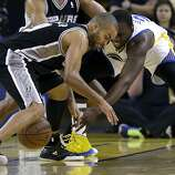 San Antonio Spurs guard Tony Parker, left, looks for the ball in front of Golden State Warriors  forward Draymond Green during the second quarter of Game 4 of a Western Conference semifinal NBA basketball playoff series in Oakland, Calif., Sunday, May 12, 2013. (AP Photo/Jeff Chiu)
