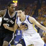 Golden State Warriors guard Klay Thompson, right, drives against San Antonio Spurs forward Kawhi Leonard during the first quarter of Game 4 of a Western Conference semifinal NBA basketball playoff series in Oakland, Calif., Sunday, May 12, 2013. (AP Photo/Marcio Jose Sanchez)