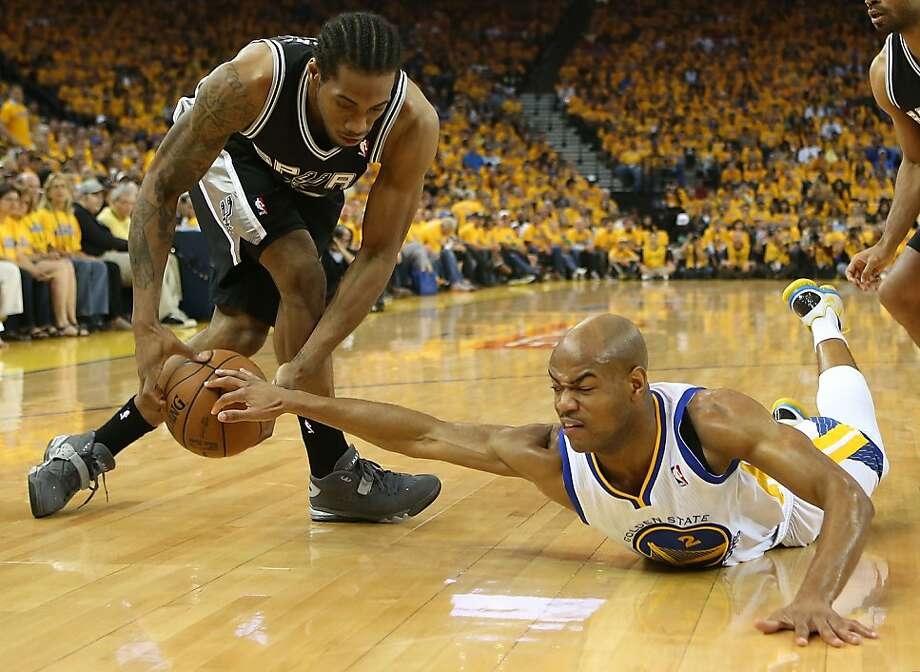 OAKLAND, CA - MAY 12:  Jarrett Jack #2 of the Golden State Warriors battles with Kawhi Leonard #2 of the San Antonio Spurs in Game Four of the Western Conference Semifinals during the 2013 NBA Playoffs on May 12, 2013 at the Oracle Arena in Oakland, California. NOTE TO USER: User expressly acknowledges and agrees that, by downloading and or using this photograph, User is consenting to the terms and conditions of the Getty Images License Agreement.  (Photo by Jed Jacobsohn/Getty Images) Photo: Jed Jacobsohn, Getty Images