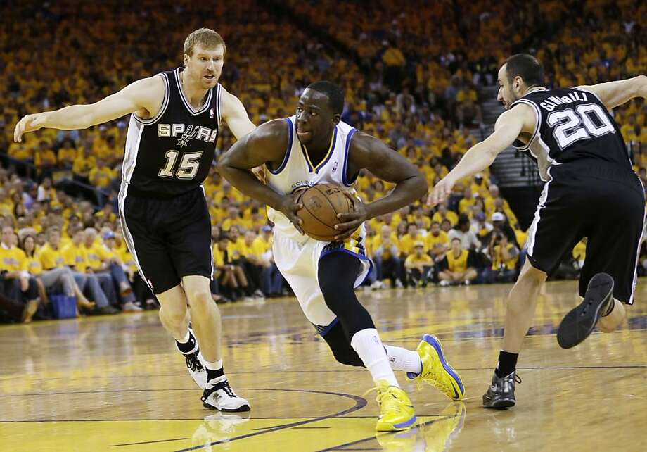 Golden State Warriors' Draymond Green, center, dribbles between San Antonio Spurs' Matt Bonner (15) and Manu Ginobili (20), of Argentina, during the first half of Game 4 of a Western Conference semifinal NBA basketball playoff series in Oakland, Calif., Sunday, May 12, 2013. (AP Photo/Marcio Jose Sanchez) Photo: Marcio Jose Sanchez, Associated Press