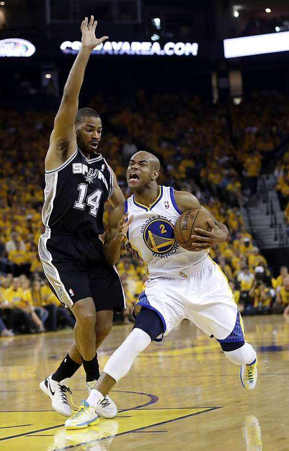 Golden State Warriors' Jarrett Jack (2) dribbles by San Antonio Spurs' Gary Neal (14) during the first half of Game 4 of a Western Conference semifinal NBA basketball playoff series in Oakland, Calif., Sunday, May 12, 2013. (AP Photo/Marcio Jose Sanchez) Photo: Marcio Jose Sanchez, Associated Press