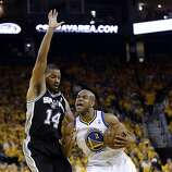 Golden State Warriors' Jarrett Jack (2) dribbles by San Antonio Spurs' Gary Neal (14) during the first half of Game 4 of a Western Conference semifinal NBA basketball playoff series in Oakland, Calif., Sunday, May 12, 2013. (AP Photo/Marcio Jose Sanchez)
