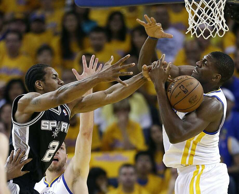 Golden State Warriors' Festus Ezeli, right, battles for a rebound against San Antonio Spurs' Kawhi Leonard (2) during the first half of Game 4 of a Western Conference semifinal NBA basketball playoff series in Oakland, Calif., Sunday, May 12, 2013. (AP Photo/Marcio Jose Sanchez) Photo: Marcio Jose Sanchez, Associated Press