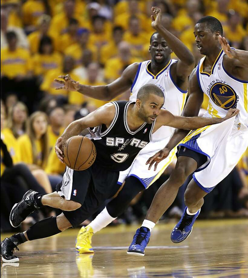 San Antonio Spurs' Tony Parker, left, dribbles next to Golden State Warriors' Draymond Green, center, and Harrison Barnes (40) during the first half of Game 4 of a Western Conference semifinal NBA basketball playoff series in Oakland, Calif., Sunday, May 12, 2013. (AP Photo/Marcio Jose Sanchez) Photo: Marcio Jose Sanchez, Associated Press