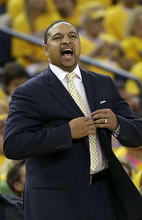Golden State Warriors head coach Mark Jackson yells to his team against the San Antonio Spurs during the second quarter of Game 4 of a Western Conference semifinal NBA basketball playoff series in Oakland, Calif., Sunday, May 12, 2013. (AP Photo/Jeff Chiu) Photo: Jeff Chiu, Associated Press