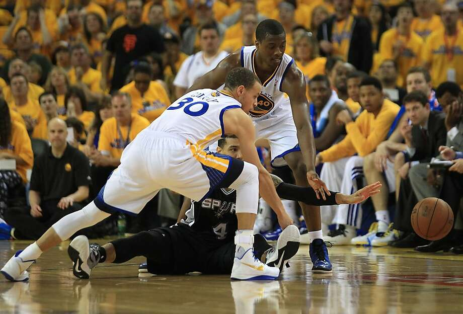 OAKLAND, CA - MAY 12:  Danny Green #4 of the San Antonio Spurs battles for the ball with Stephen Curry #30 and Harrison Barnes #40 of the Golden State Warriors in Game Four of the Western Conference Semifinals during the 2013 NBA Playoffs on May 12, 2013 at the Oracle Arena in Oakland, California. NOTE TO USER: User expressly acknowledges and agrees that, by downloading and or using this photograph, User is consenting to the terms and conditions of the Getty Images License Agreement.  (Photo by Jed Jacobsohn/Getty Images) Photo: Jed Jacobsohn, Getty Images