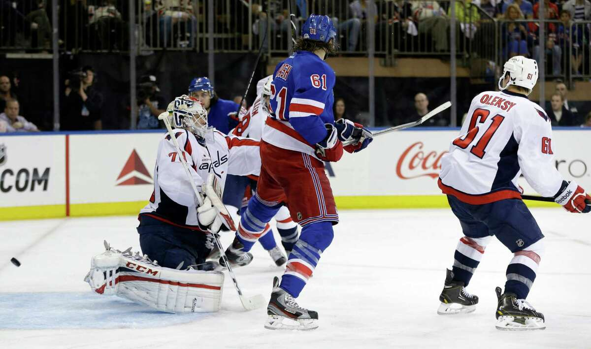 New York Rangers left wing Rick Nash (61) scores a goal past Washington Capitals goalie Braden Holtby (70) in the second period of Game 6 of their NHL Stanley Cup hockey playoff series in New York, Sunday, May 12, 2013.