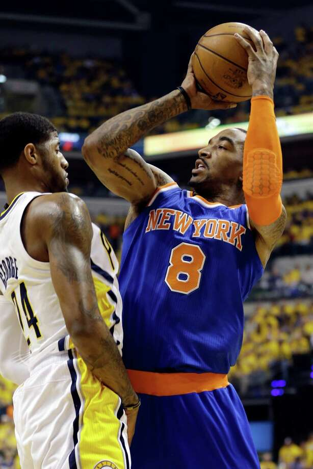 New York Knicks' J.R. Smith (8) shoots over Indiana Pacers' Paul George (24) during the first half of Game 3 of an Eastern Conference semifinal NBA basketball playoff series in Saturday, May 11, 2013, in Indianapolis. (AP Photo/Darron Cummings) Photo: Darron Cummings, Associated Press / AP