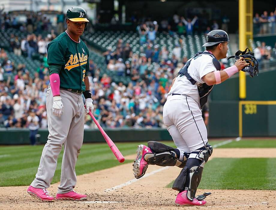 SEATTLE, WA - MAY 12:  Michael Taylor #23 of the Oakland Athletics looks on after striking out for the final out as catcher Jesus Montero #63 of the Seattle Mariners heads to the mound to celebrate at Safeco Field on May 12, 2013 in Seattle, Washington.  (Photo by Otto Greule Jr/Getty Images) Photo: Otto Greule Jr, Getty Images