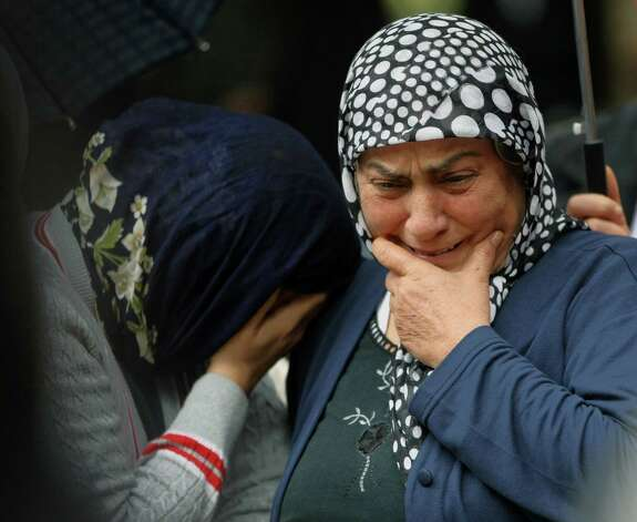 Mourning relatives cry as pallbearers carry the coffin of Fehmi Karaca, 69, a shop owner and one 46 victims killed in Saturday explosions for burial in Reyhanli, near Turkey's border with Syria, Sunday, May 12, 2013. The bombings marked the biggest incident of cross-border violence since the start of Syria's bloody civil war and have raised fear of Turkey being pulled deeper into the conflict. Photo: Burhan Ozbilici, Associated Press / AP