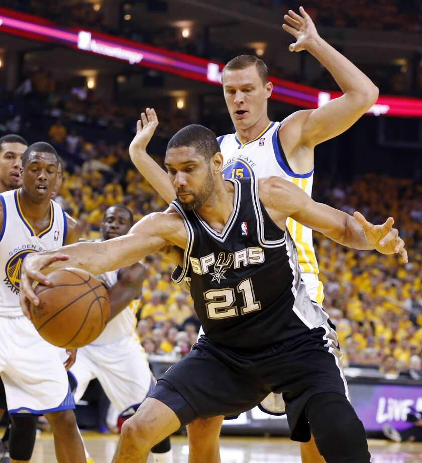 The Spurs' Tim Duncan grabs for a loose ball around the Warriors' Andris Biedrins during first half action in Game 4 of the Western Conference semifinals Sunday, May 12, 2013 at Oracle Arena in Oakland.