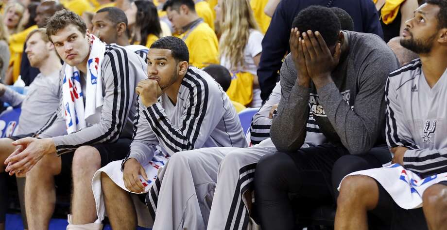 The Spurs' Tiago Splitter, (from left), Cory Joseph,  DeJuan Blair and Patty Mills sit dejected on the bench late in overtime action of Game 4 in the Western Conference semifinals against the Warriors on Sunday, May 12, 2013 at Oracle Arena in Oakland. The Warriors won 97-87 in overtime.