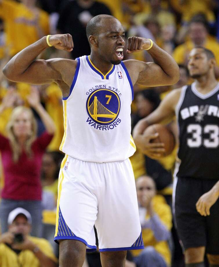The Warriors' Carl Landry celebrates after scoring during second half action in Game 4 of the Western Conference semifinals against the Spurs on Sunday, May 12, 2013 at Oracle Arena in Oakland. The Warriors won 97-87 in overtime.