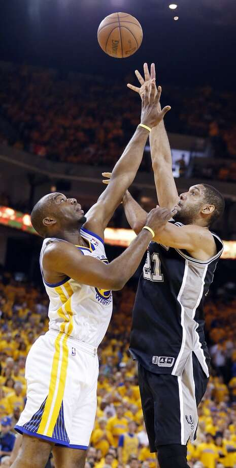 The Spurs' Tim Duncan shoots over the Warriors' Carl Landry during second half action in Game 4 of the Western Conference semifinals Sunday, May 12, 2013 at Oracle Arena in Oakland. The Warriors won 97-87 in overtime.