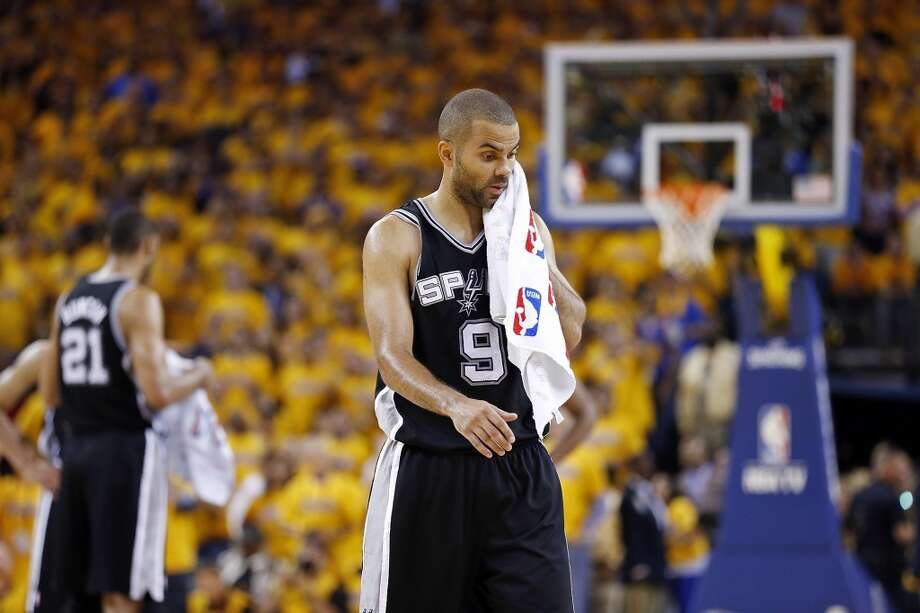The Spurs' Tony Parker wipes his face during overtime action in Game 4 of the Western Conference semifinals against the Warriors on Sunday, May 12, 2013 at Oracle Arena in Oakland. The Warriors won 97-87 in overtime.