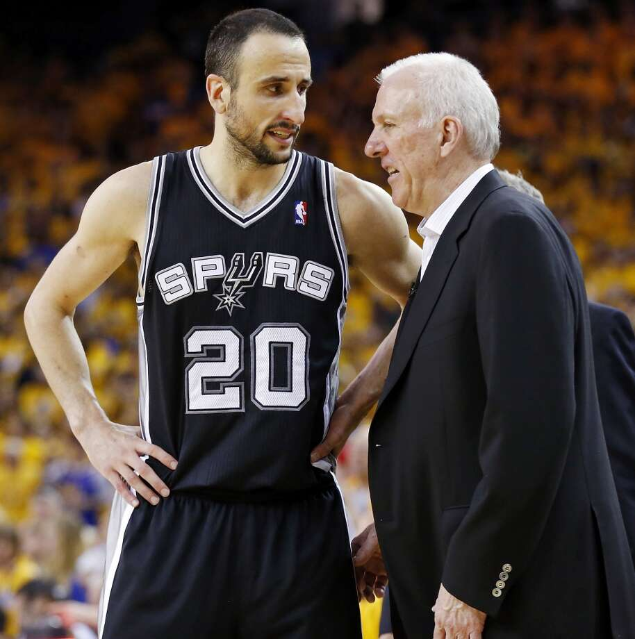 The Spurs' Manu Ginobili talks with Spurs coach Gregg Popovich during overtime action in Game 4 of the Western Conference semifinals against the Golden State Warriors on Sunday, May 12, 2013 at Oracle Arena in Oakland. The Warriors won 97-87 in overtime.