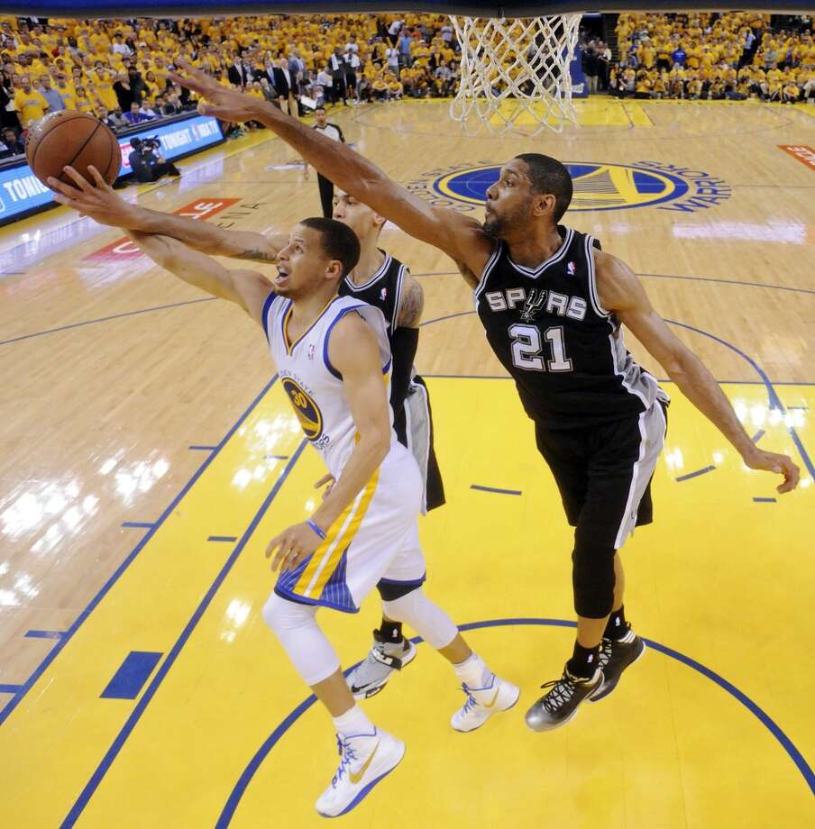 The Warriors' Stephen Curry shoots around the Spurs' Danny Green and Tim Duncan during Game 4 of the Western Conference semifinals Sunday, May 12, 2013 at Oracle Arena in Oakland. The Warriors won 97-87 in overtime.