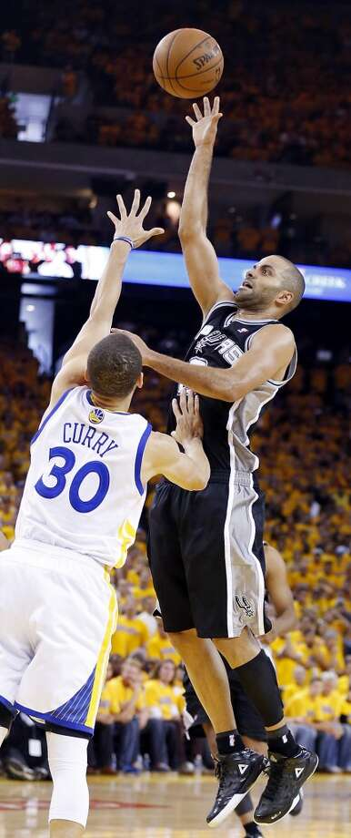 The Spurs' Tony Parker shoots over the Warriors' Stephen Curry during second half action in Game 4 of the Western Conference semifinals Sunday, May 12, 2013 at Oracle Arena in Oakland. The Warriors won 97-87 in overtime.