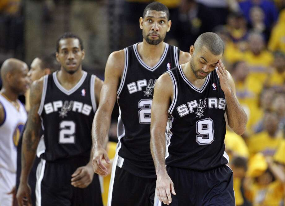 The Spurs' Kawhi Leonard (from left), Tim Duncan, and Tony Parker walk to the bench during a timeout in overtime action of Game 4 of the Western Conference semifinals against the Golden State Warriors on Sunday May 12, 2013 at Oracle Arena in Oakland. The Warriors won 97-87 in overtime.